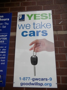 Goodwill We Take Cars sign