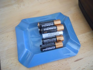 Batteries on a blue dish