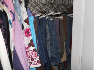 Blue jeans hanging in the closet