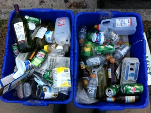 Curbside bins filled with a week's worth of recyclables