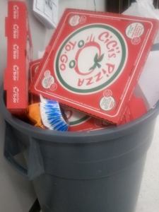Pizza boxes in trash