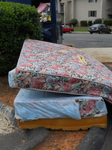 Mattresses beside the dumpster