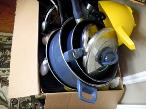 pots and pans in a box