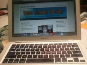 Apple laptop with Think Outside The Bin website